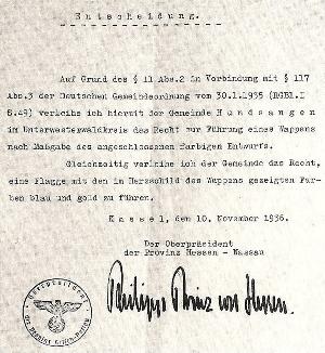 Mit diesem Schreiben des Oberpräsidenten der Provinz Hessen-Nassau, Prinz Philipp von Hessen vom 10. November 1936 wurde der Gemeinde Hundsangen das Führen eines Wappens und einer Flagge genehmigt.